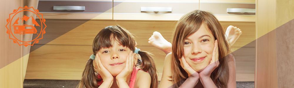 Kids posing RV lifestyle drawers organization