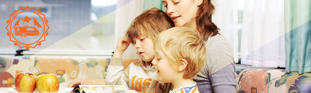 Kids reading with mom RV lifestyle