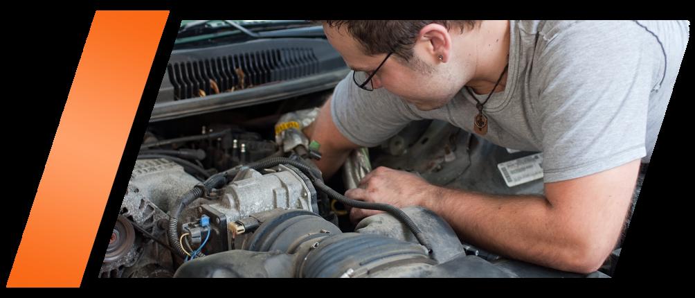 Man looking at engine