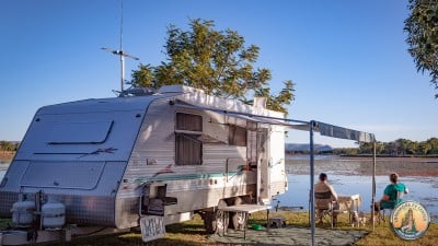 Couple RVing lakeside.