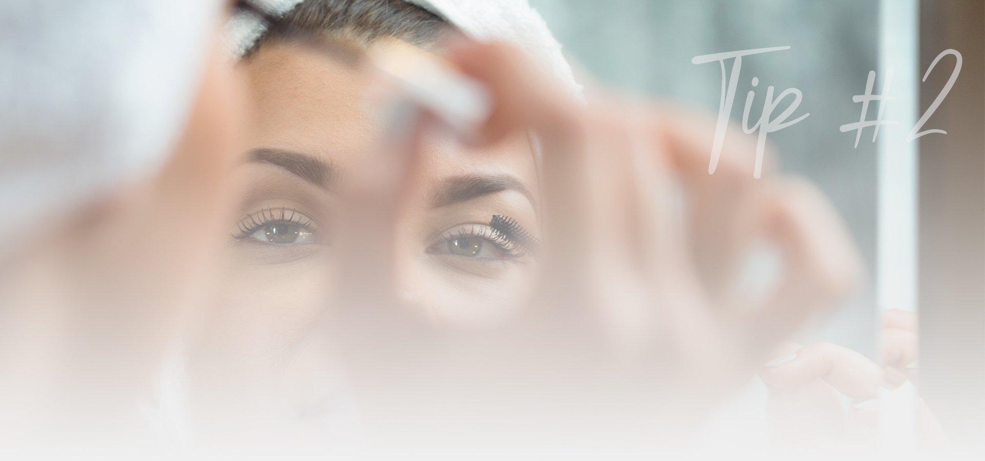 Woman putting on make-up