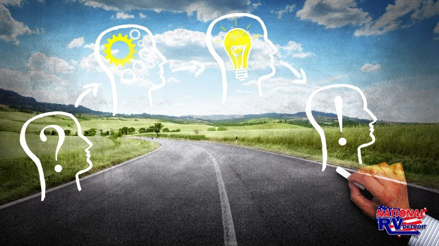 Illustrated faces with light bulbs and exclamation points overlaying an open road