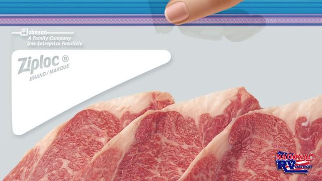 Hand holding steak in a freezer bag