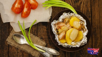 Chicken and potato dinner with tomatoes