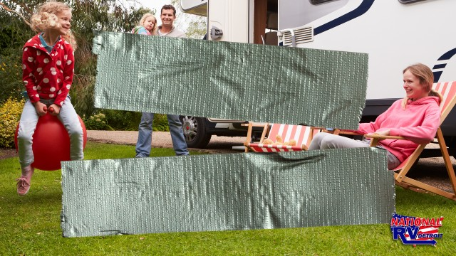 Duct tape across image of RVing family playing outside