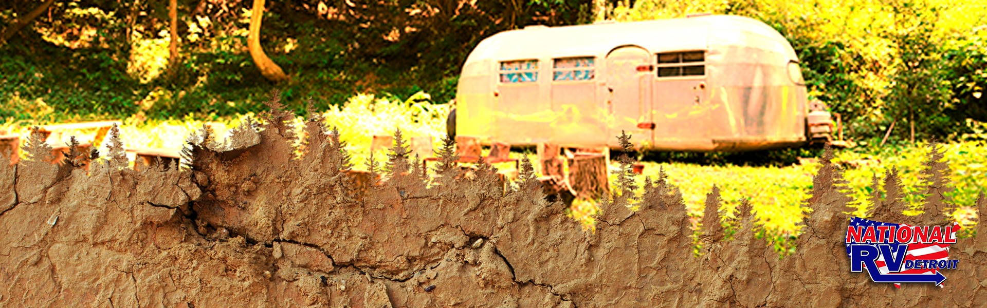 cutout of tree line in dirt - travel trailer in the woods