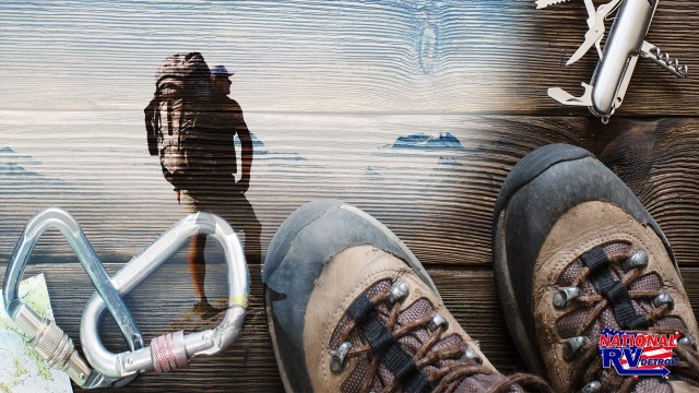 Hiking gear  backpacker overlooking mountain scape
