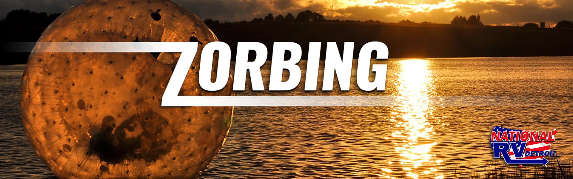 zorbing on the lake at sunset - ourdoor water game