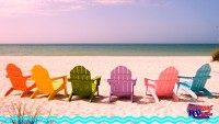 Colorful beach chairs lining oceanfront