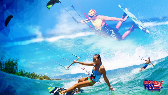 Girl and guys kiteboarding kitesurfing