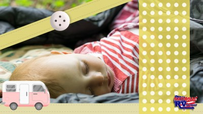 Sleeping baby with illustrated ribbons and RV
