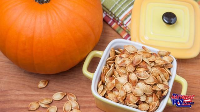 Roasted pumpkin seeds with a pumpkin