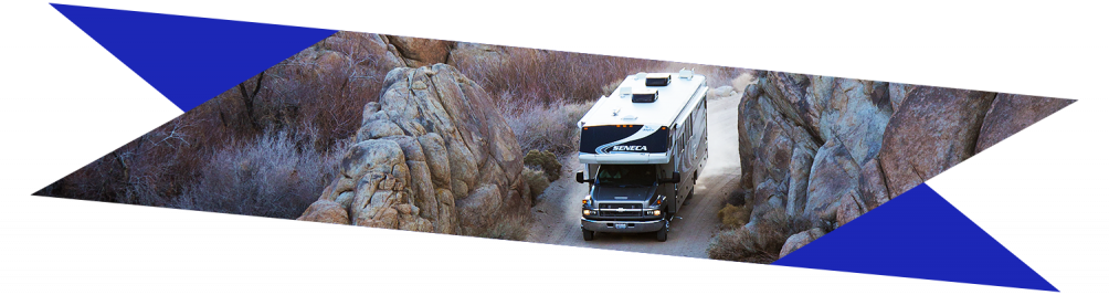 Motorhome driving through rocky desert
