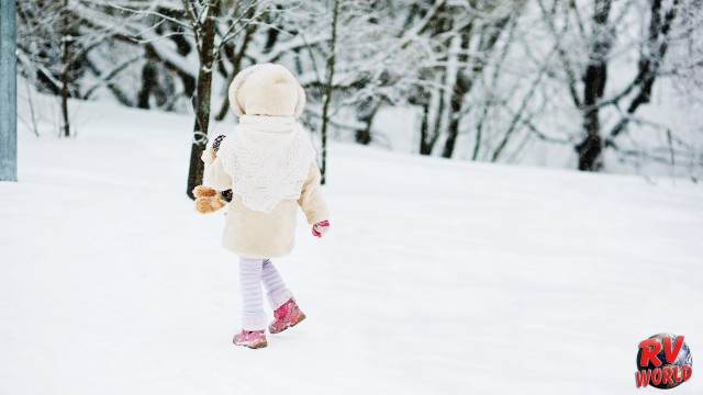 Girl playing outside in the snow