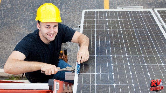 guy installing solar panel