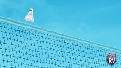 Birdie Flying Over Net In A Game Of Badminton