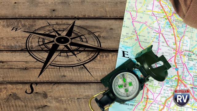 Map And Compass Sitting On Picnic Table