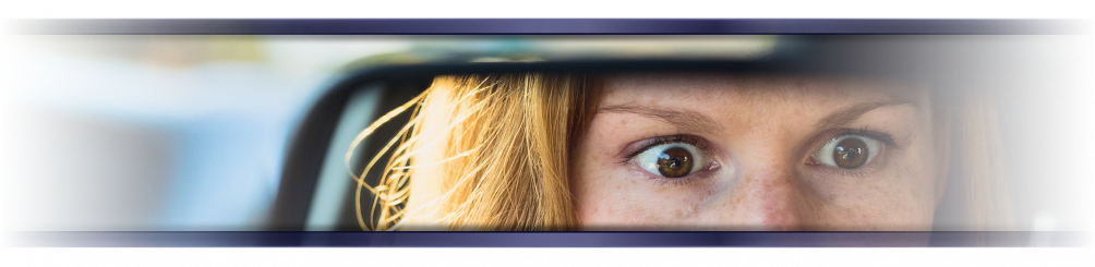 Girls scared in car rear view mirror