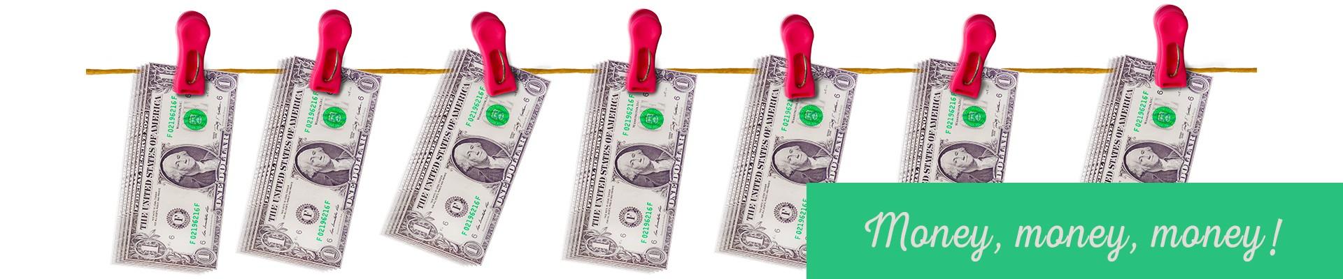 Money money money! dollar bills hanging by clothes pins