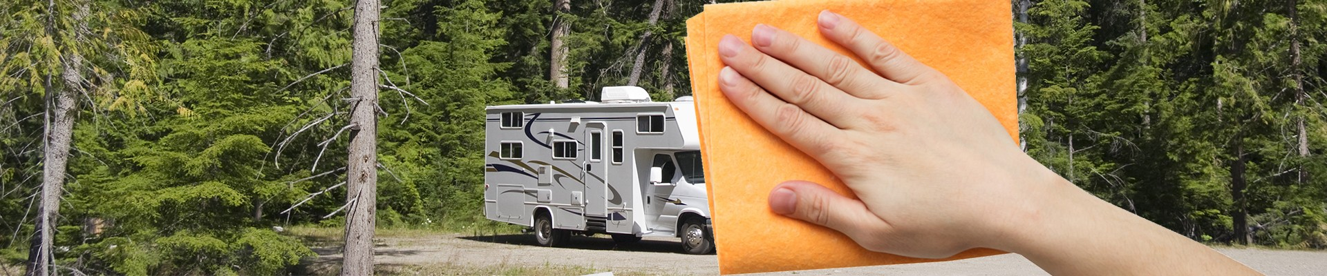 motorhome and hand with cleaning rag