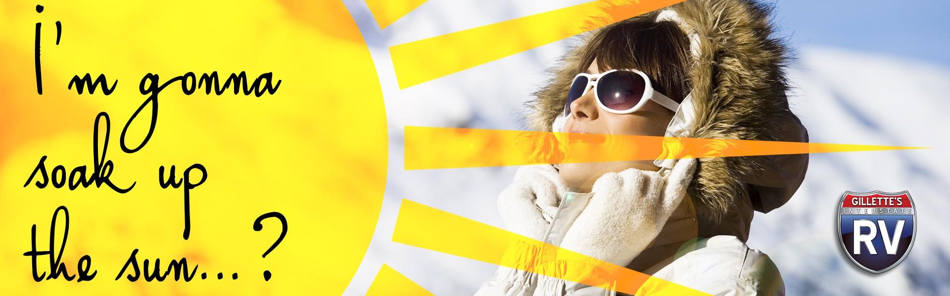 I'm gonna soak up the sun…? Woman sunbathing in winter