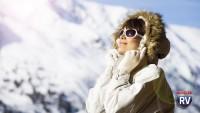Woman sunbathing in winter
