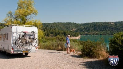 Dog And Owner With Camper