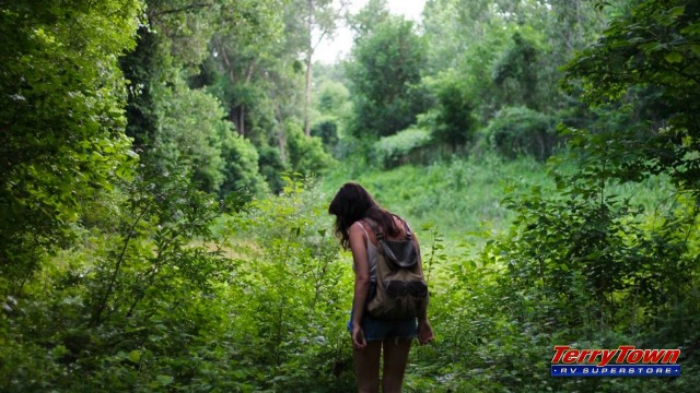 girl geocaching in the woods