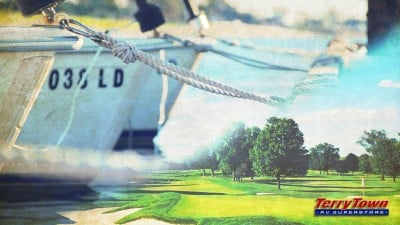 boat at dock and golf course