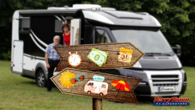 Wooden sign pointing to an RV vacation or stressful work with retired RVing couple in the background