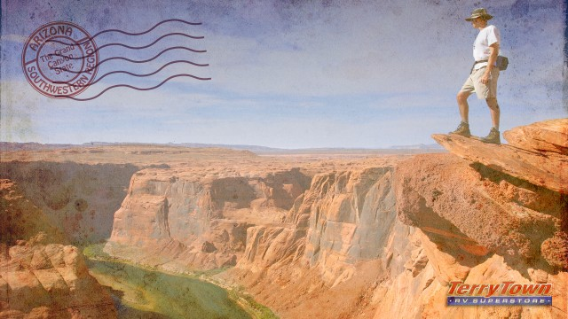postcard of man overlooking Grand Canyon