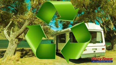 recycling symbol rv overlooking lake and mountains