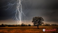 severe thunderstorm striking ground out in the country