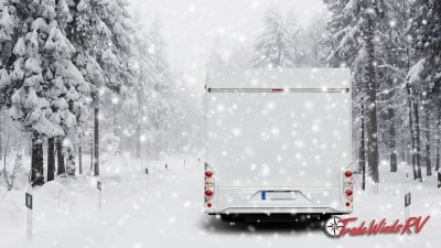 RV Driving Down Snow Covered Road In A Blizzard