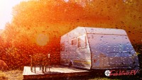 Travel trailer RV at sunset with condensation overlay