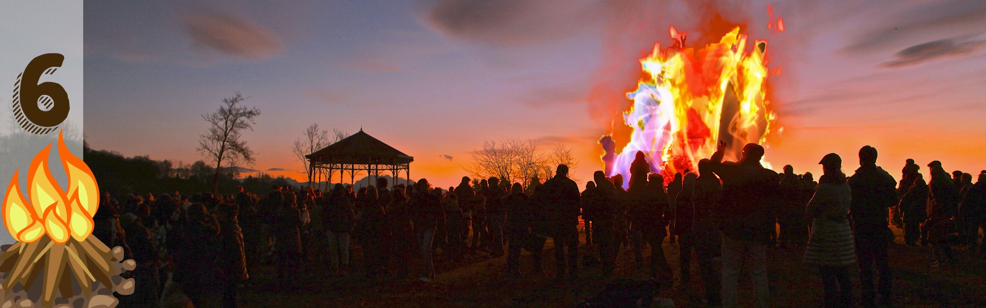 huge crowd surrounded by bonfire with rainbow colors at sunset