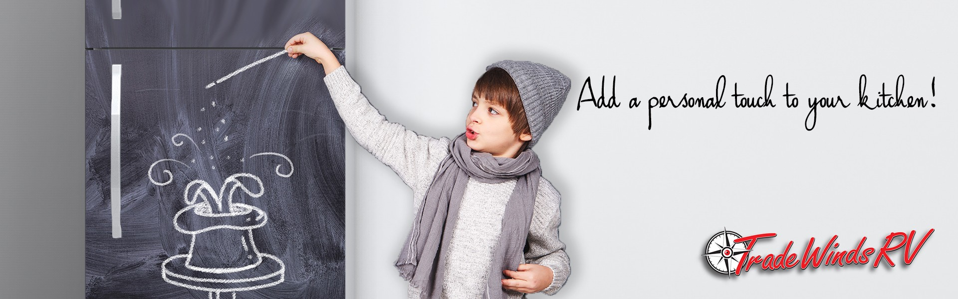 Add a personal touch to your kitchen! Boy drawing with chalk on fridge.
