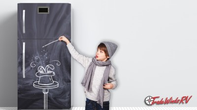 Boy Drawing With Chalk On Kitchen Fridge
