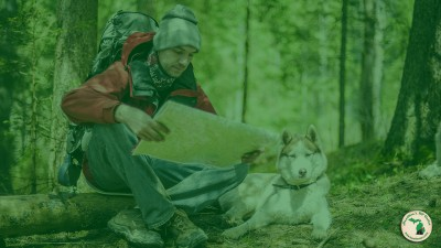 Man And Dog On A Hike Looking At Map