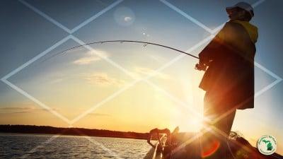 Fisherman on lake at sunset with net pattern overlaying