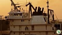 Ship at locks at sunset
