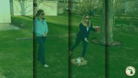 Girls playing washers yard games Feature