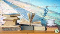 Stack of books with lone traveler