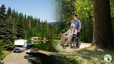 Older gentleman in a wheelchair with his grandson while RVing.