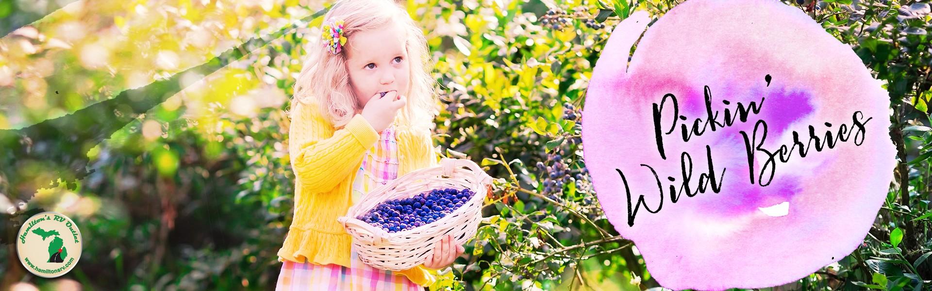 Young girl pickin' wild berries