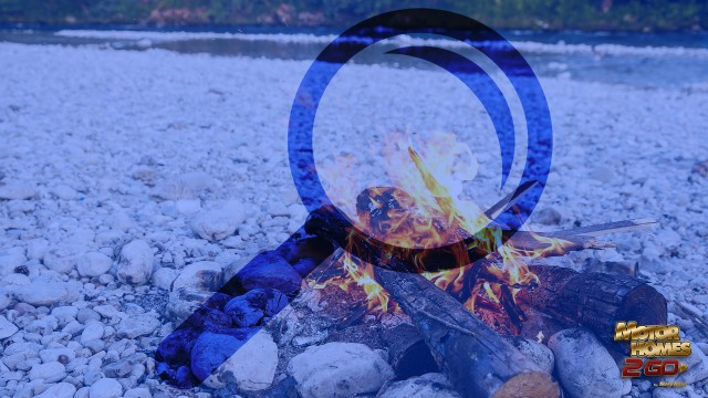 Bonfire On The Beach With Magnifying Glass Overlay