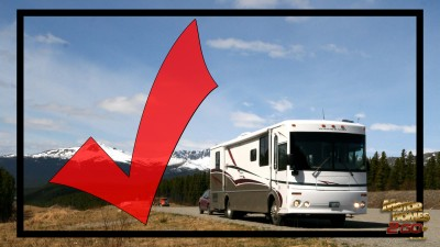 Check mark RV motorhome driving through mountains