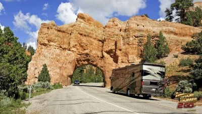 Motor Home Traveling Out West Through The Mountains