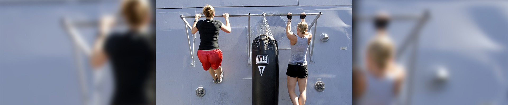 two women doing pull ups