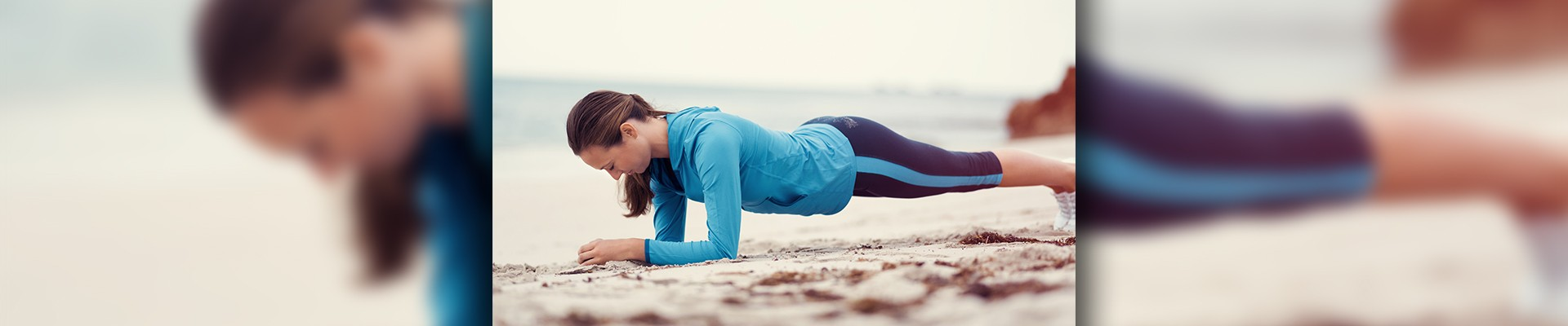 woman planking on the beach
